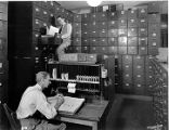 [Men working in a file room at a Florida Citrus Exchange office]