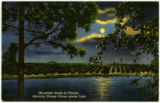 Moonlight scene in Florida, showing orange grove across the lake